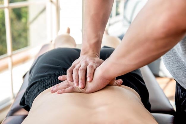 massage kiné mal de dos
